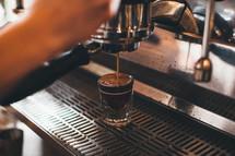 barista pouring espresso