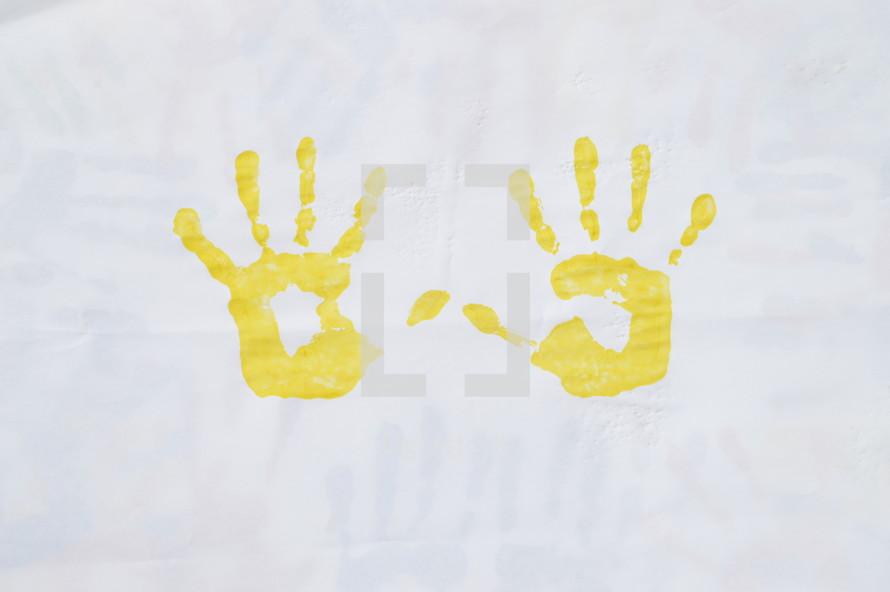 yellow hand prints