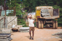 man in India carrying water