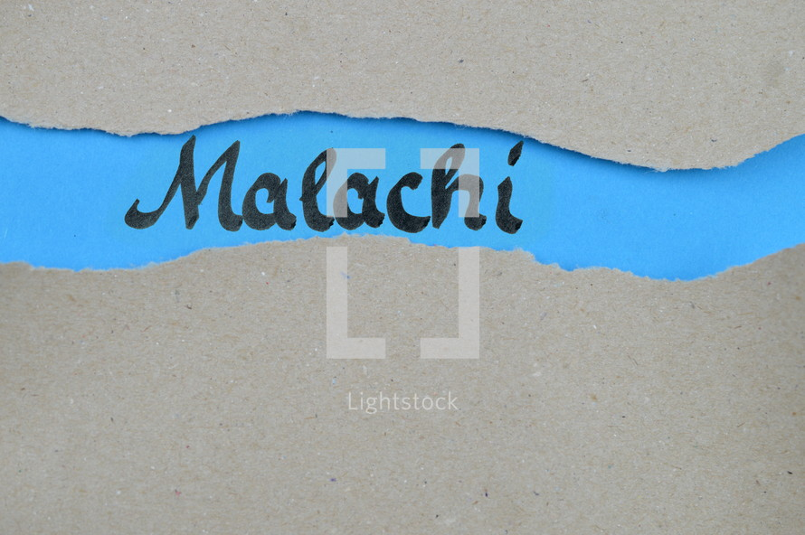 Malachi - torn open kraft paper over blue paper with the name of the prophetic book Malachi