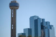 Reunion Tower and the Dallas skyline in the day.