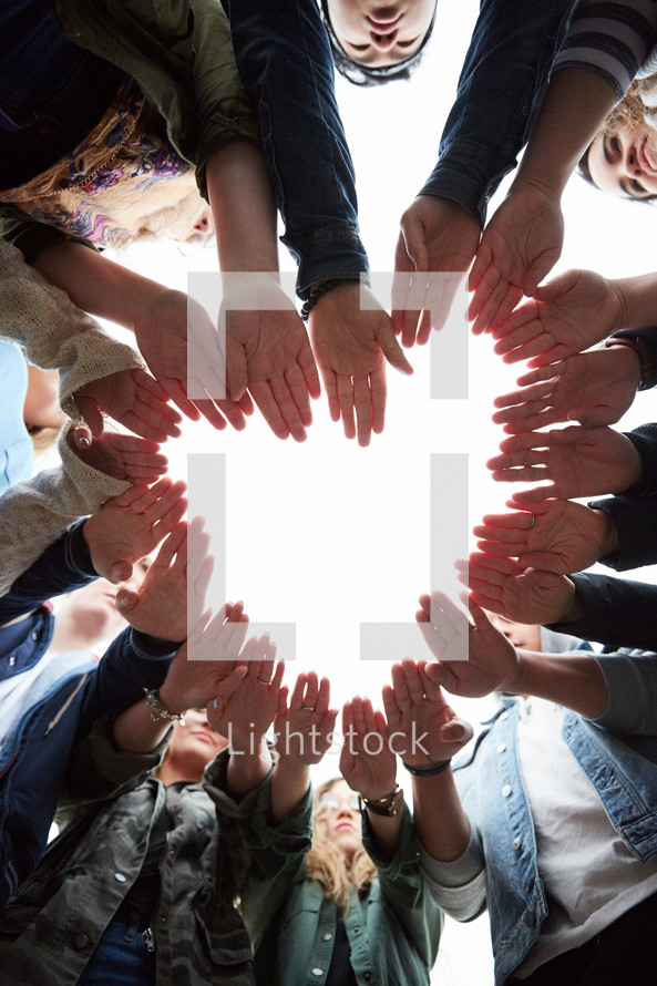 group of teens making a heart with their hands