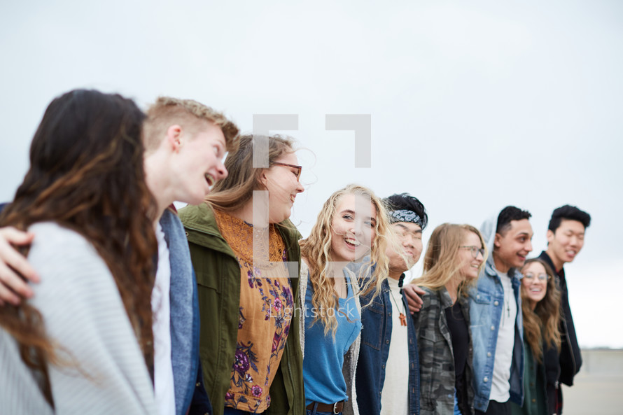 a group of teens with arms around each other