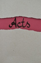 Acts - torn open kraft paper over dark red paper with the name of the book of Acts