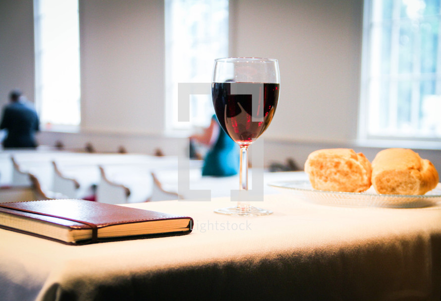 communion bread and wine at the altar