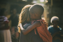 missionary hugging a young child in Kenya