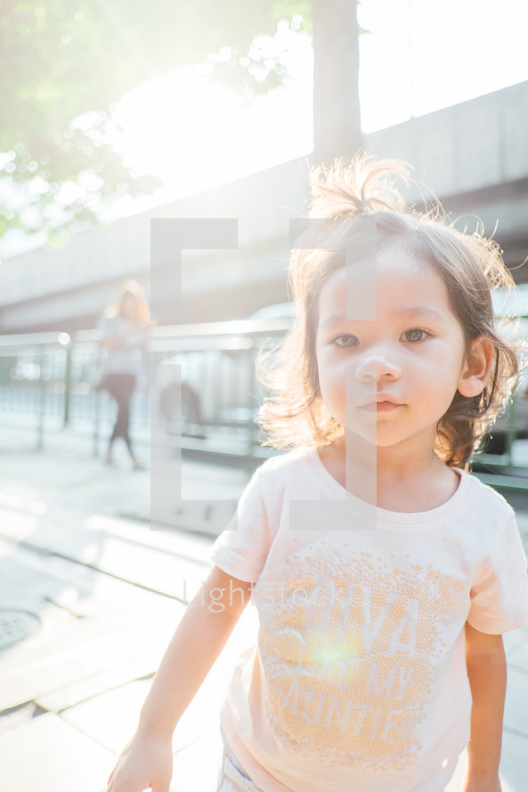face of a little girl in bright sunlight