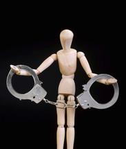 a figurine in handcuffs