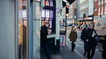 pedestrians on a downtown sidewalk