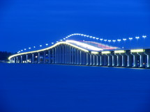 outline of a lighted bridge at night