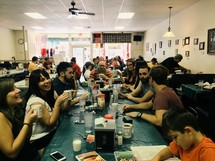 friends and family eating in a restaurant