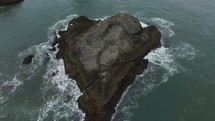 aerial over a small rock island