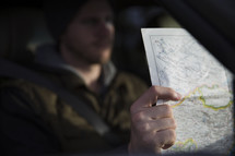 man looking at a road map