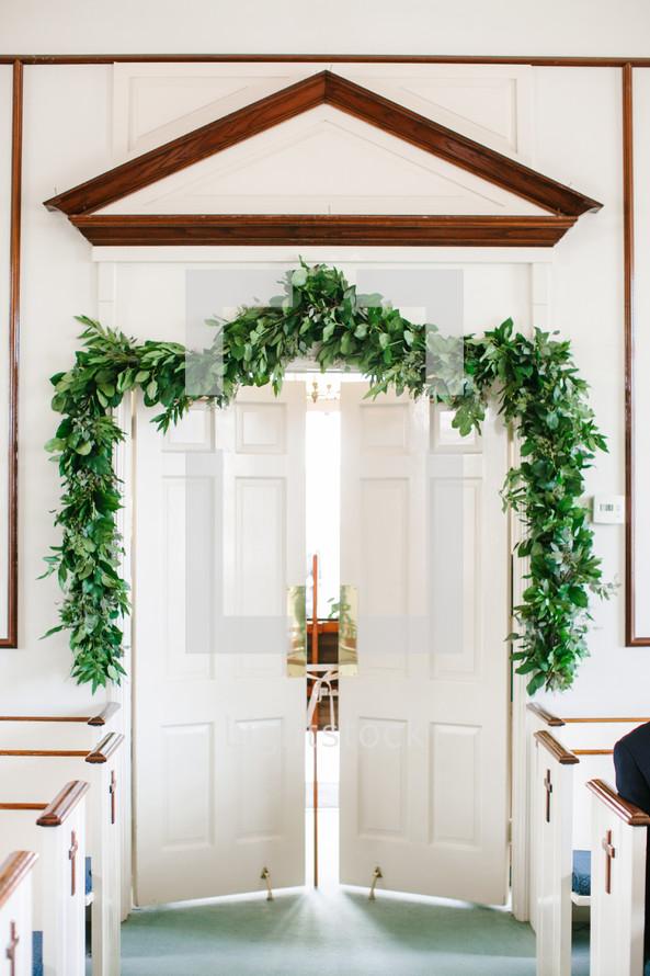 church doors cracked open