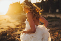 bride running in the sand on a beach