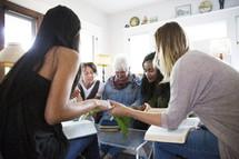 woman's group Bible study praying together