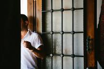a man standing in a doorway