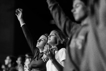 youth praising God at a concert