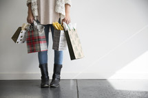 woman holding Christmas gift bags