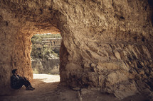 man siitting in a cave
