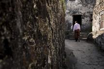 man walking in an alley