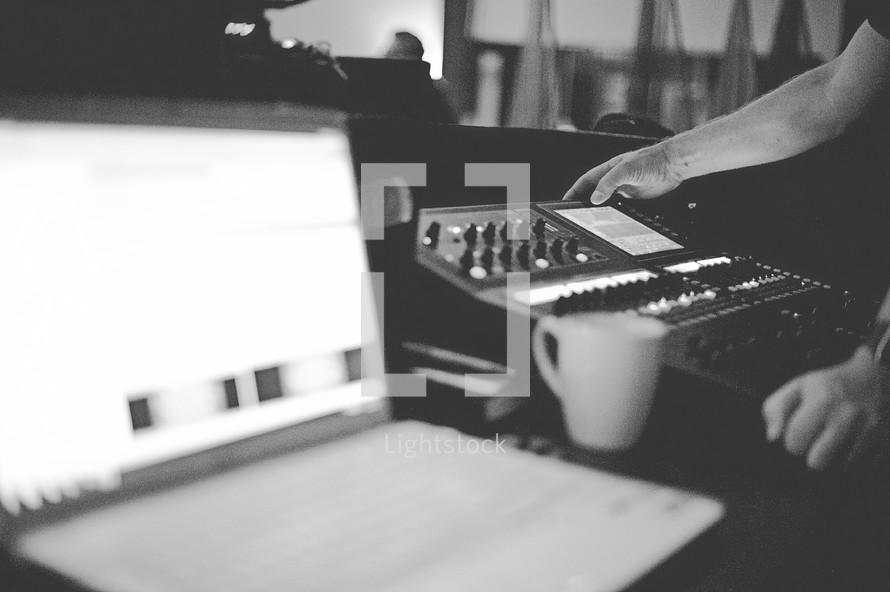 a man at a soundboard