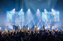 musicians on stage at a youth conference