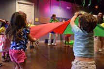 children playing with a parachute at VBS