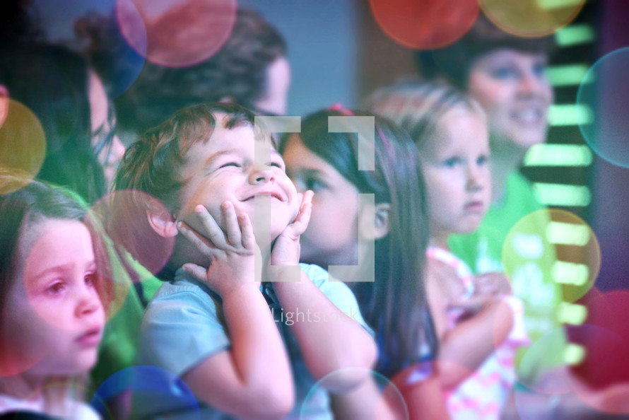 happy young children and bokeh light