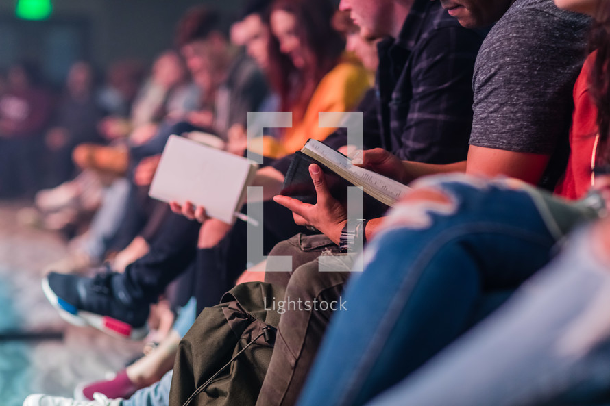 people reading Bibles at a group Bible study