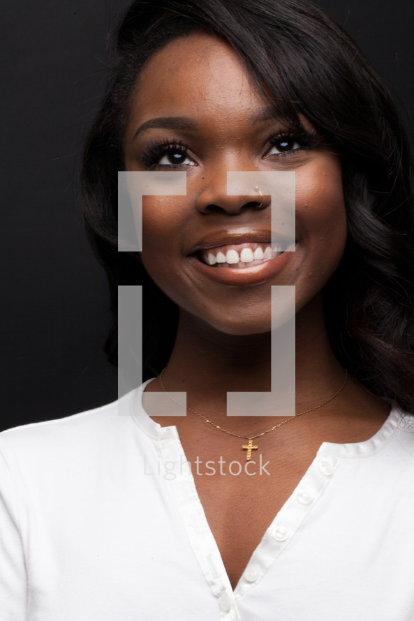 A smiling woman looking up to God