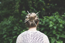 a woman with a bun in her hair