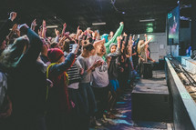 raised hands, clapping hands, clapping, audience, woman, standing, praise, worship, worship service, rally, youth rally