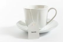 tea cup with the word sacred on the tea bag