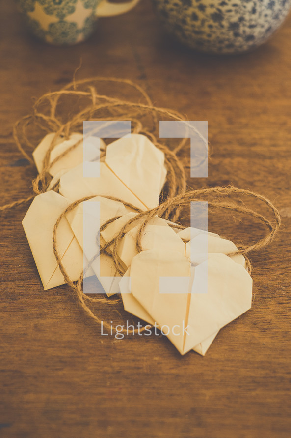 Paper hearts with twine hangers.