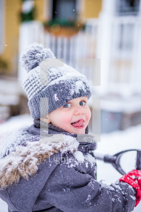a toddler playing in snow