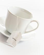 tea cup with the word sorrow on the tea bag