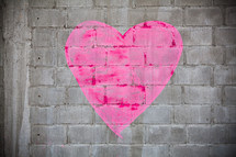 Heart painted on a brick wall.