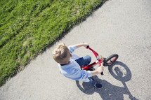 boy child riding his bike