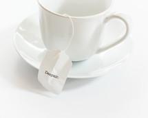 tea cup with the word despair on the tea bag