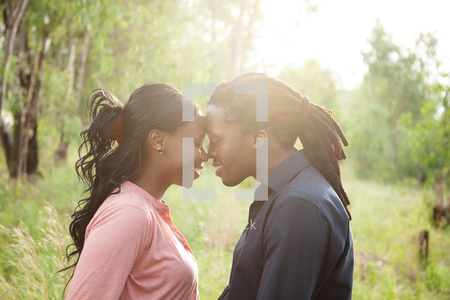 couple standing forehead to forehead