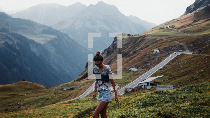 a woman walking on a mountaintop