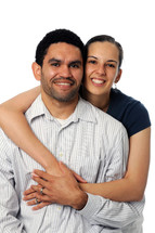 A woman with her arms around a man.