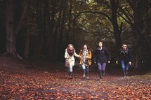 youth running outdoors in fall