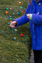 putting up Christmas lights outdoors
