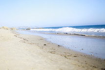 waves washing onto a coastline