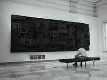 man enjoying art in a museum