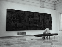 man enjoying art in a museum