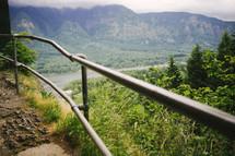 metal poles of a mountain guard rail
