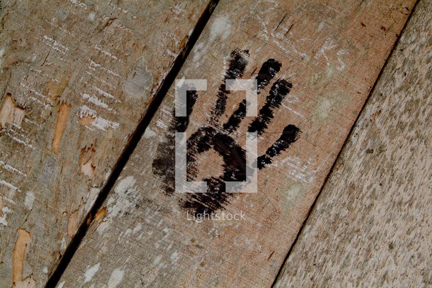 Native hand print on wooden door